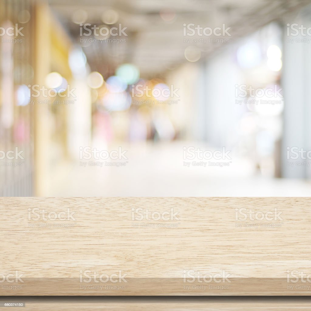 Empty table and blurred store with bokeh background, product display template royalty-free stock photo