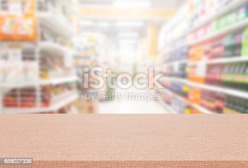istock Empty table and blurred supermarket background, product montage display 658027336