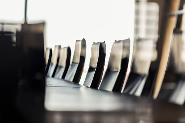 Empty table and chairs in board room at office stock photo