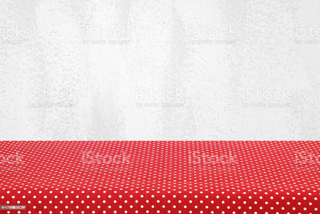 Empty table covered with red polka dot tablecloth stock photo
