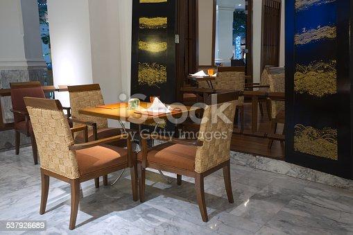 847138534 istock photo Empty table in luxury restaurant 537926689