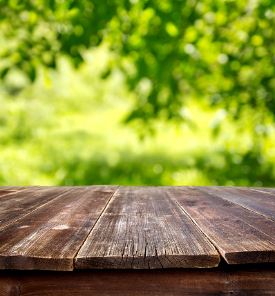 wooden table against defocused summer background