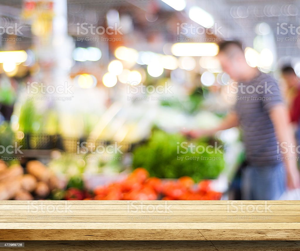 Empty table over blur supermarket background stock photo