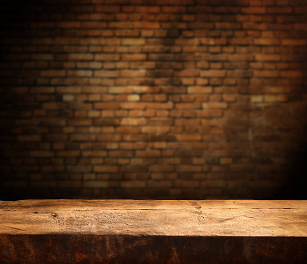 empty table Empty wooden table and brick wall in background table stock pictures, royalty-free photos & images
