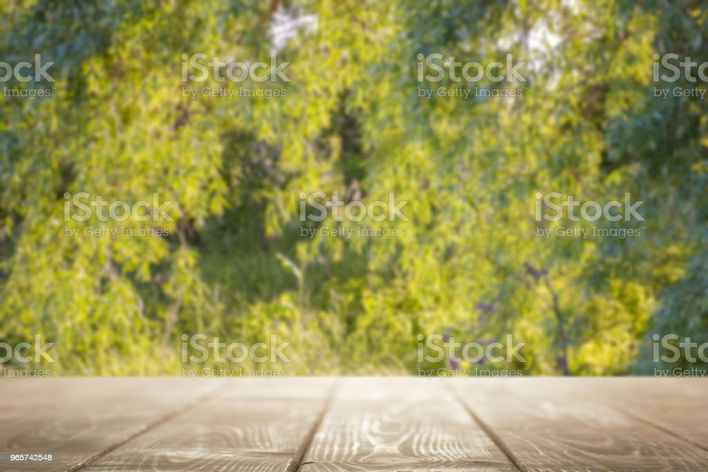 Empty table top on a green natural background - Royalty-free Abstract Stock Photo