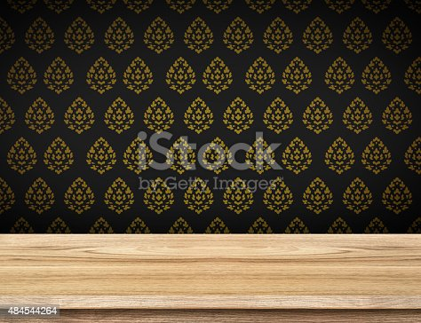 642100994istockphoto Empty table top with black wallpaper with Thai pattern wall 484544264