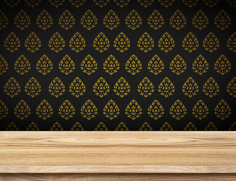 593305530 istock photo Empty table top with black wallpaper with Thai pattern wall 484544264