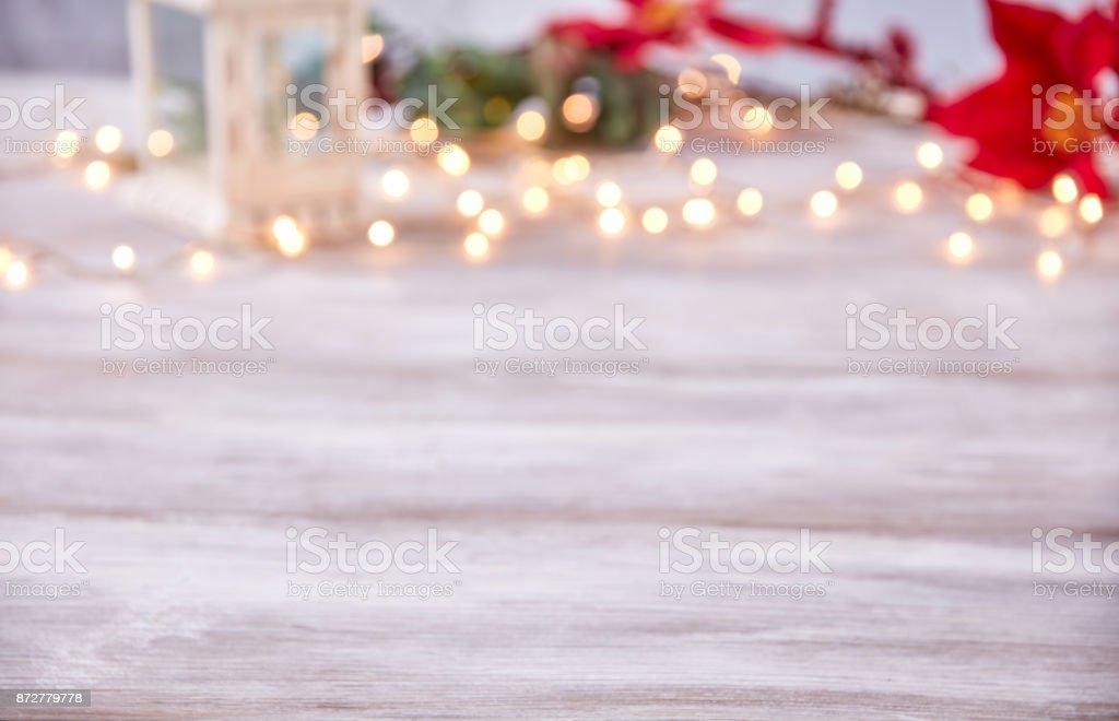 empty table top with bokeh christmas lights stock photo