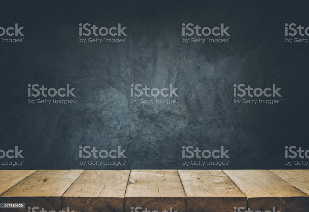 Empty table top with cement wall background.