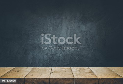istock Empty table top with cement wall background. 917339656
