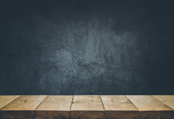 empty table top with cement wall background. - kitchen counter stock photos and pictures