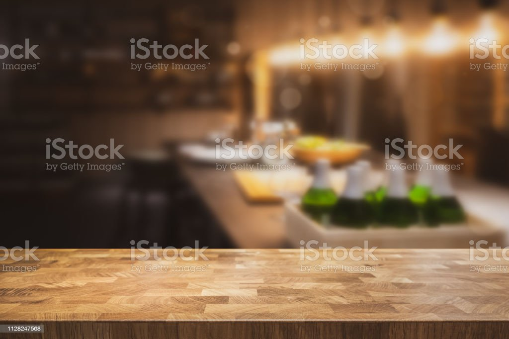 Empty Table Top With Dark Restaurant Kitchen Blurred In The Background Stock Photo Download Image Now Istock