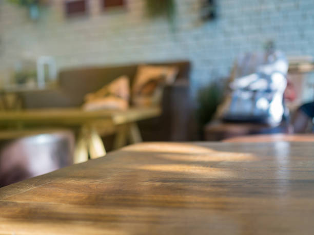 Empty table with blurry cafe background stock photo