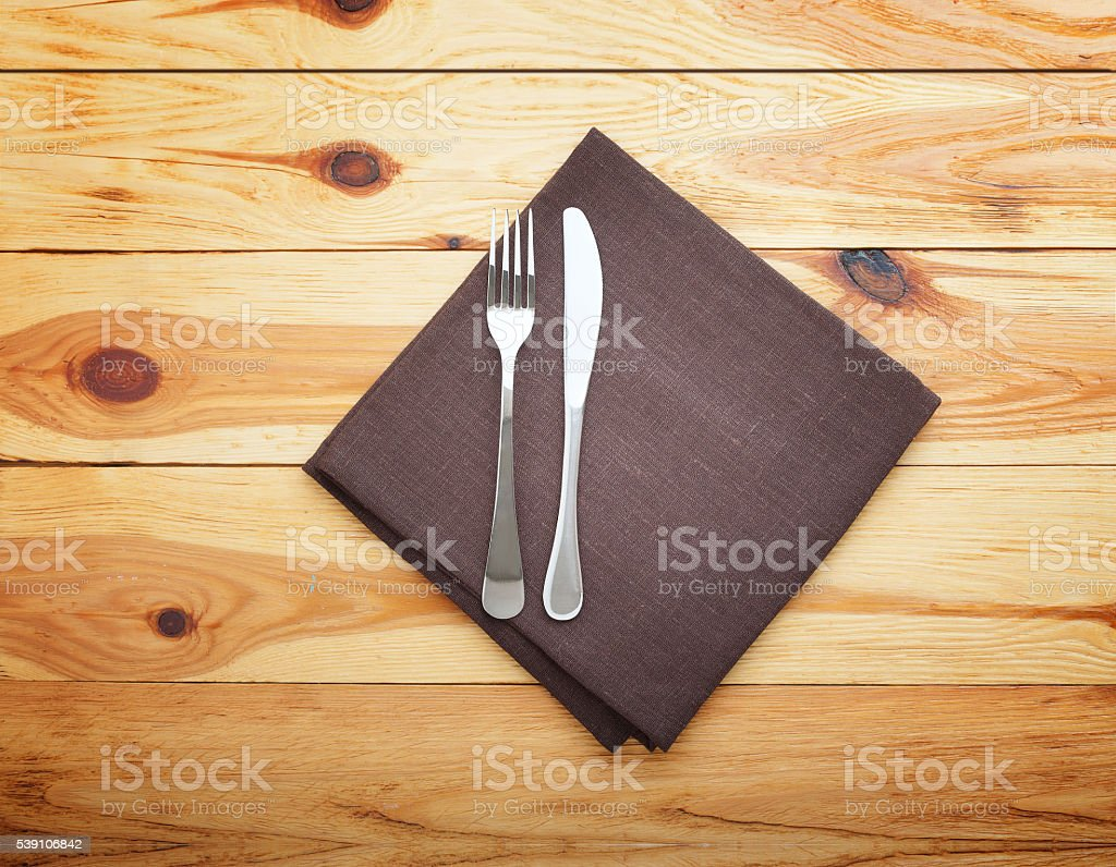Empty tablecloth on wooden table for dinner. Top view horizontally. stock photo