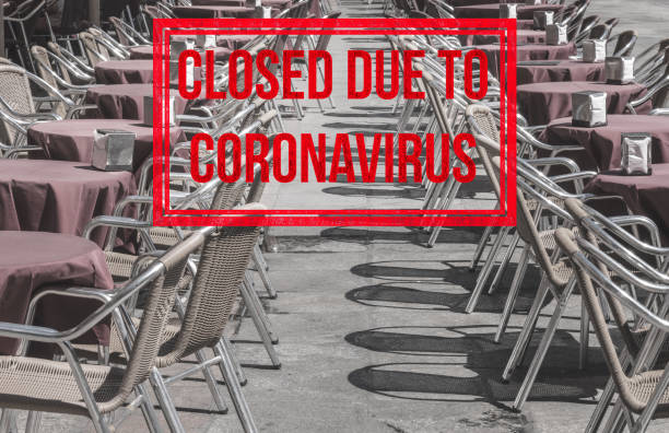 Empty tables and chairs of local restaurant in Salamanca closed due to virus of Covid-19 stock photo