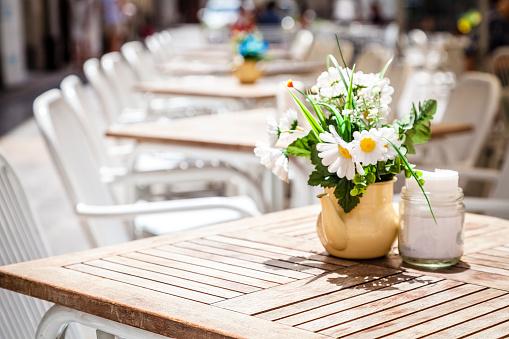 Empty tables at sidewalk cafe
