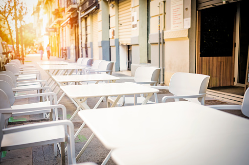 istock Empty tables at sidewalk cafe 1178991300