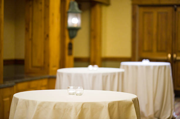 Empty Tables with Tablecloths and Burning Candles stock photo