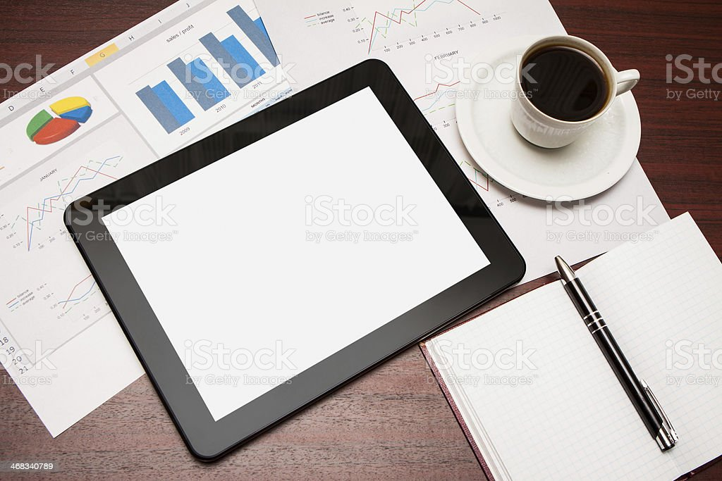 empty tablet and a cup of coffee in office stock photo