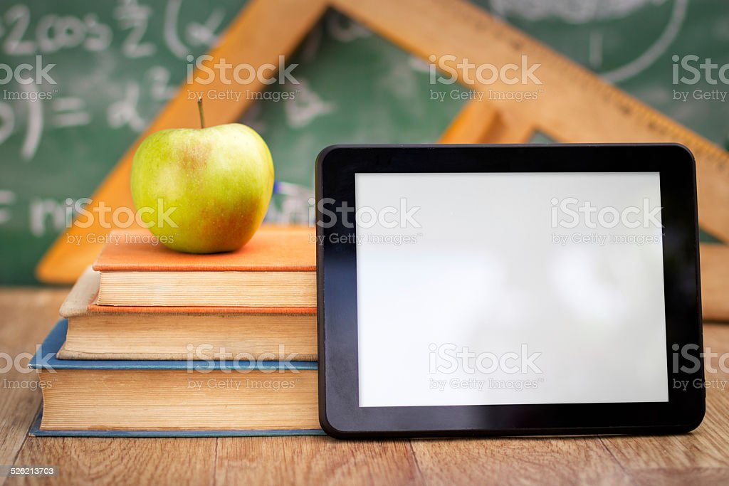 Empty tablet pc with books stock photo