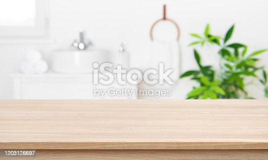 istock Empty tabletop for product display with blurred bathroom interior background 1203126697