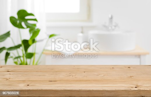 istock Empty tabletop for product display with blurred bathroom interior background 907933026