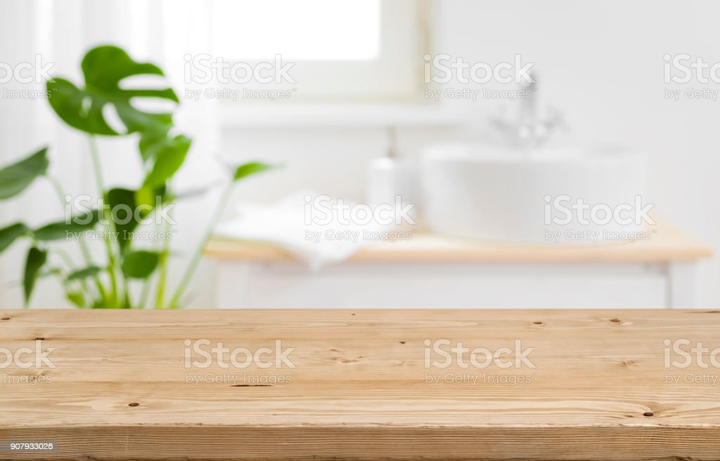 Empty tabletop for product display with blurred bathroom interior background stock photo