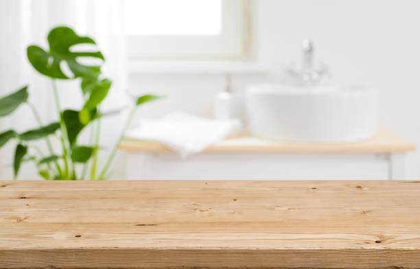 empty tabletop for product display with blurred bathroom interior background - surface level stock photos and pictures
