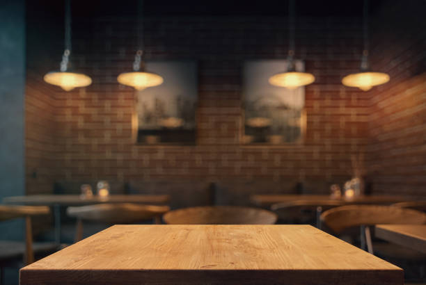 Empty tabletop in the coffe shop Empty tabletop in the coffe shop at night over defocused background with copy space restaurants stock pictures, royalty-free photos & images