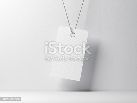 istock Empty tag label Mockup tied on rope against white wall 1021757856