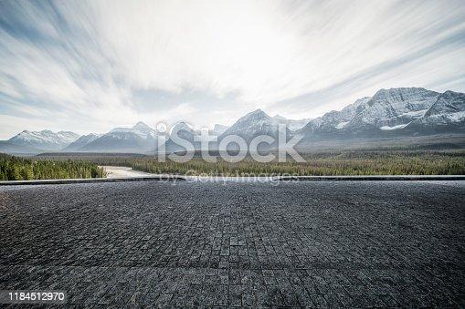 Empty tarmac road with dramatic landscape on background,Banff,Alberta,Canada.