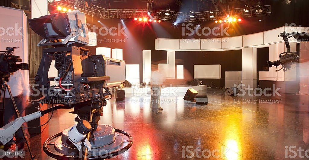 Empty television studio with camera stock photo