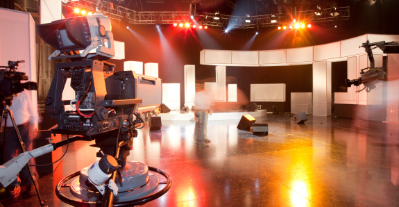 Empty Television Studio With Camera Stock Photo - Download Image Now