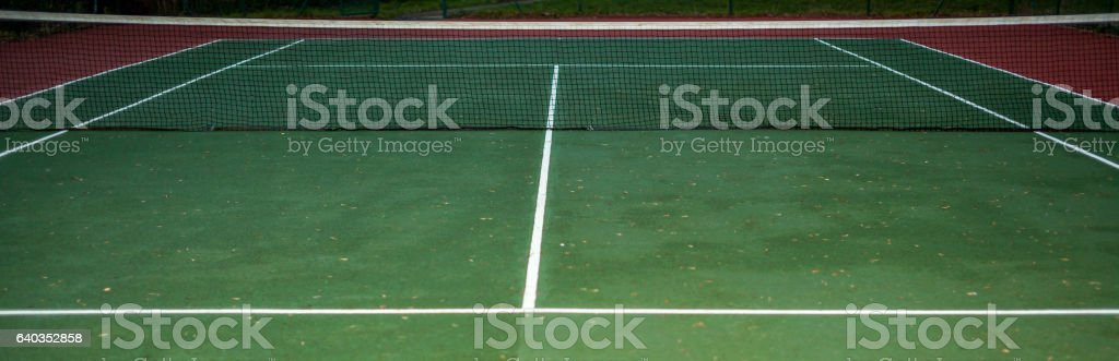 Empty tennis court stock photo