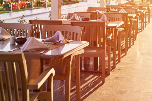 empty terrace with a table and chairs outdoor in sunset - covid restaurant imagens e fotografias de stock