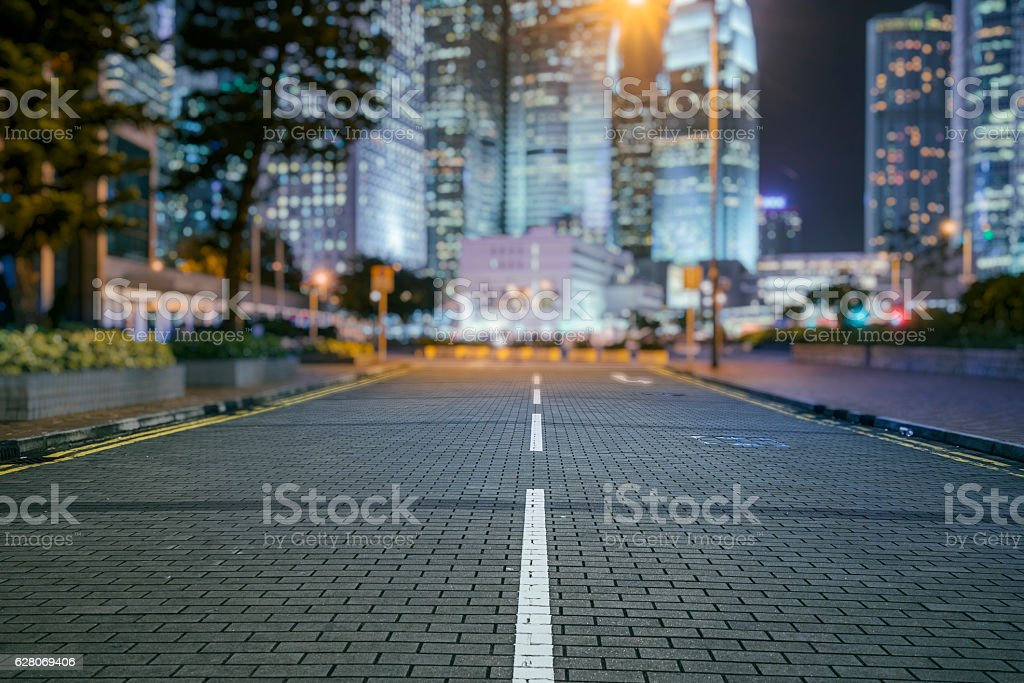 empty tiled floor with blurred cityscape of Hong Kong background stock photo