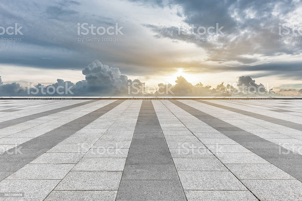 empty tiled floor with cloudy sky stock photo
