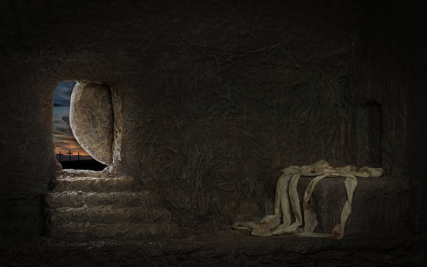 Empty Tomb of Jesus Empty tomb of Jesus with crosses in far hill tomb stock pictures, royalty-free photos & images