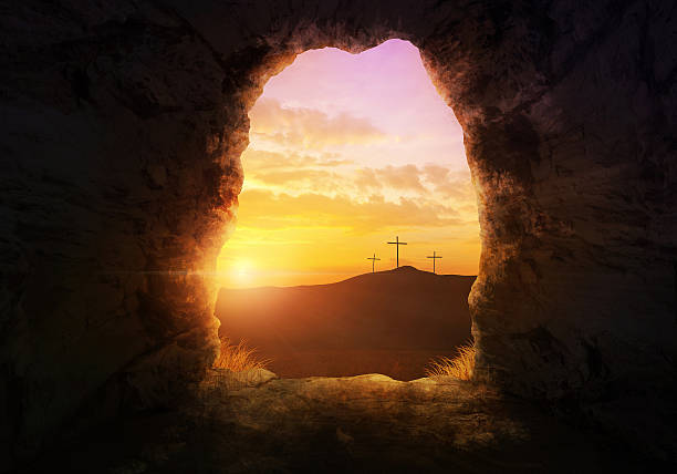 Empty tomb Empty tomb with three crosses on a hill side. tomb stock pictures, royalty-free photos & images