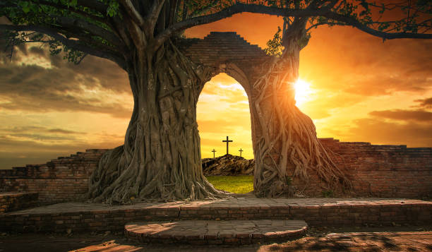 Empty tomb with three crosses stock photo