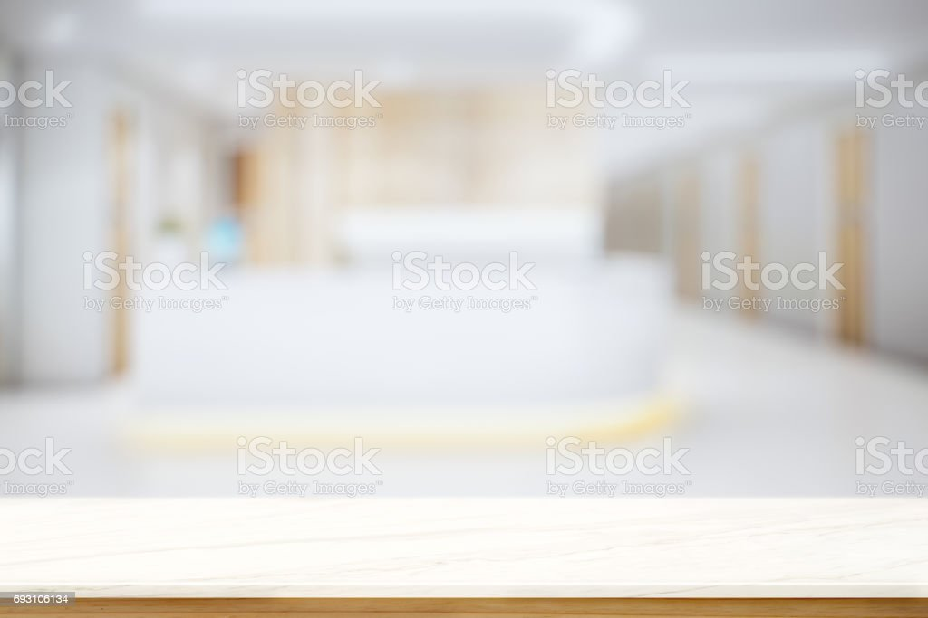 Empty Top Mable and wood table at hospital counter background. stock photo