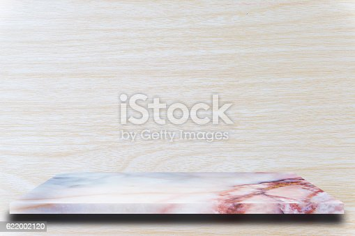 671896388istockphoto Empty top marble shelves and wooden wall background 622002120