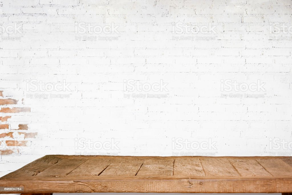 Empty top of natural wooden table and retro white brick wall background. stock photo