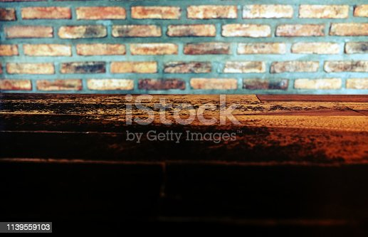 642100994istockphoto Empty top of wooden table or counter isolated on rustic brick Texture background. For product display 1139559103