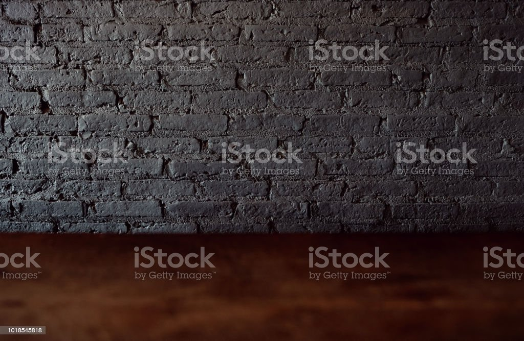 Empty top of wooden table or counter isolated on rustic focus wall...