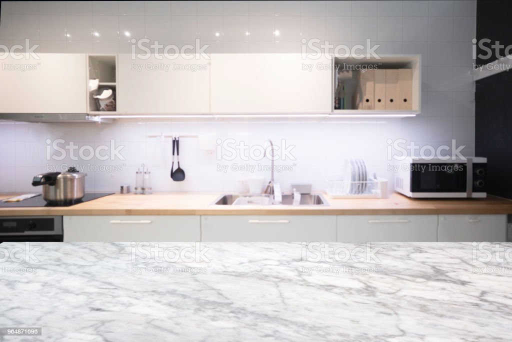 Empty top White marble Table and blurred on blur kitchen interior background. For present your products display. . royalty-free stock photo