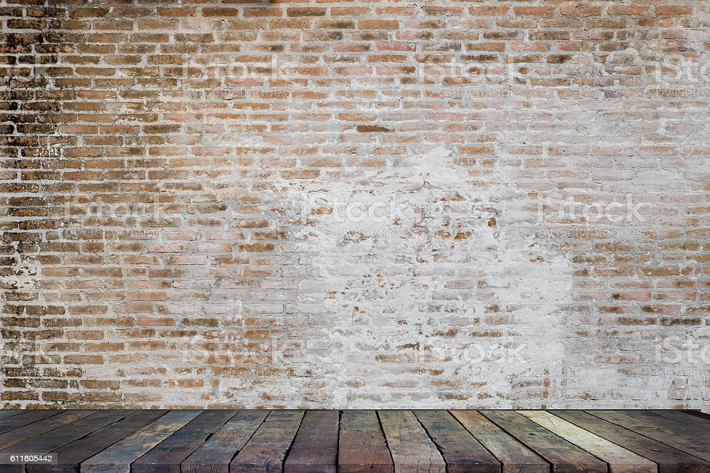 Empty top wood in front of a red brick wall