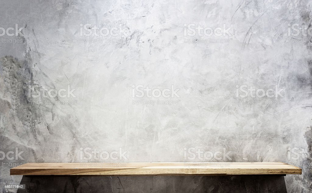 Empty top wooden shelves and stone wall background stock photo