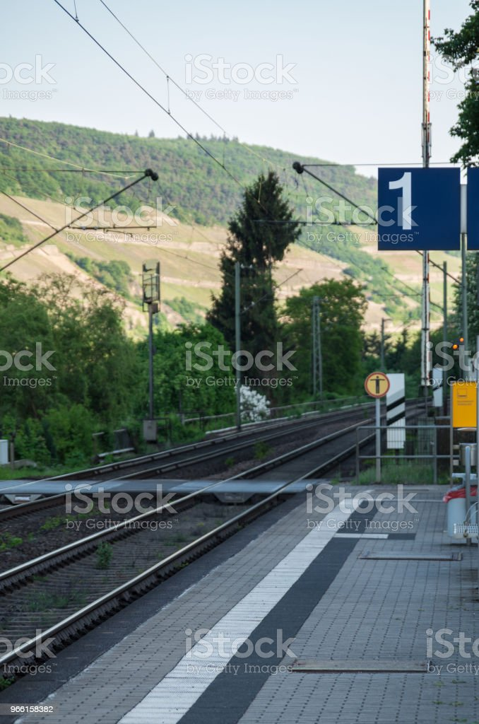 Empty train tracks in the countryside with platform number in focus - Royalty-free Day Stock Photo
