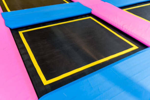 empty trampoline waiting for children, lean place stock photo